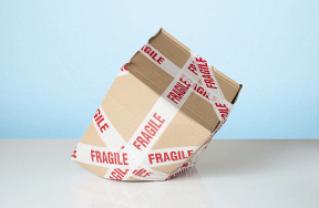 Dropping cardboard box marked fragile