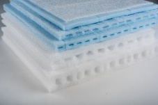 blue and white foam used as pads and toppers for mattresses