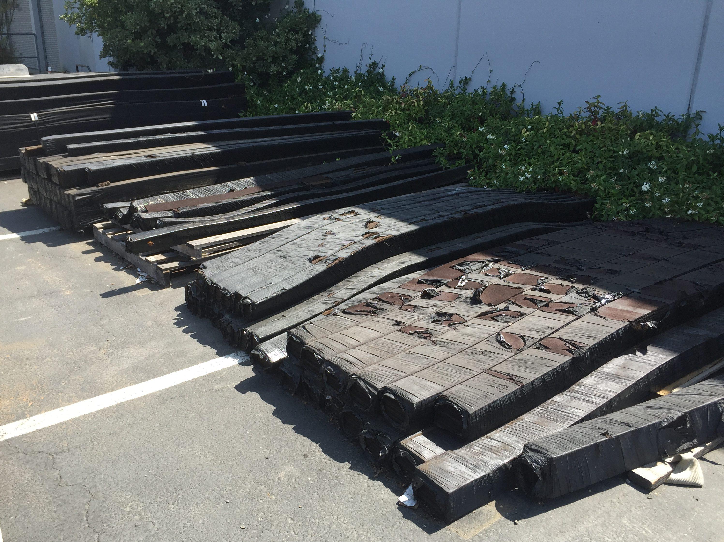 photo of deteriorating fiberboard in contractor yard
